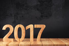 2017 New year digits on the wooden table. 2017 New year digits on wooden table on dark grunge background. 3d render Stock Photography