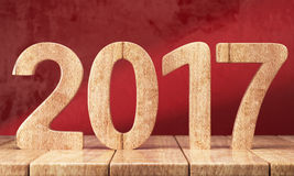 2017 New year digits on the wooden table. Wooden 2017 New year digits on wooden table on red grunge background. 3d render Royalty Free Stock Images