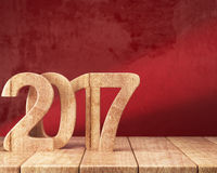 2017 New year digits on the wooden table. Wooden 2017 New year digits on wooden table on red grunge background. 3d render Stock Photography