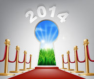 New Year Door Keyhole 2014. Concept of a keyhole with a new dawn over verdant landscape and red carpet and ropes leading up to it Stock Photos
