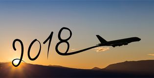 New year 2018 drawing by airplane on the air at sunrise. New year 2018 drawing by airplane on the air at sunset Royalty Free Stock Photo