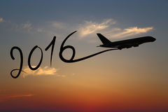 New year 2016 drawing by airplane. On the air at sunset stock illustration