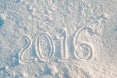 New Year 2016 drawing. Toned date of New Year 2016 drawed on the first soft snow Royalty Free Stock Photography