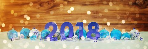 2018 new year eve with christmas baubles and candles 3D renderin. 2018 new year eve with blue and white christmas baubles and candles 3D rendering Stock Photos