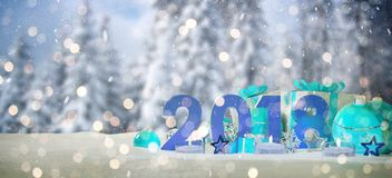 2018 new year eve with christmas baubles and gifts 3D rendering. 2018 new year eve with blue and white christmas baubles and gifts 3D rendering Royalty Free Stock Photo