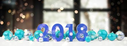 2018 new year eve with christmas baubles lined up 3D rendering. 2018 new year eve with blue and white christmas baubles on snow background 3D rendering Royalty Free Stock Photography