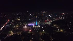 New Year eve celebration in National Monument. Beautiful aerial view of New Year 2018 eve celebration in National Monument at Central Jakarta, Indonesia stock footage