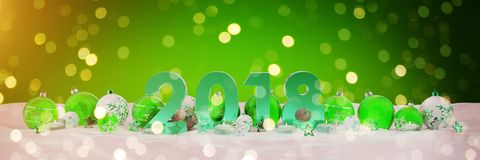 2018 new year eve with christmas baubles and candles 3D renderin. 2018 new year eve with green and white christmas baubles and candles 3D rendering Stock Photography