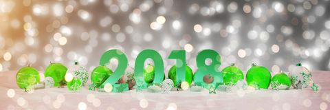 2018 new year eve with christmas baubles and candles 3D renderin. 2018 new year eve with green and white christmas baubles and candles 3D rendering stock illustration