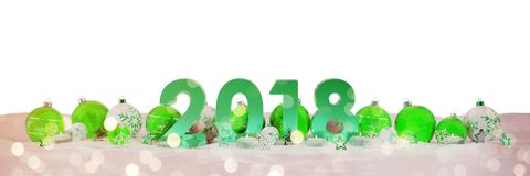 2018 new year eve with christmas baubles and candles 3D renderin. 2018 new year eve with green and white christmas baubles and candles 3D rendering Stock Images
