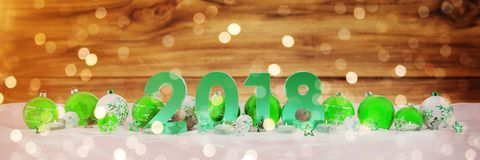 2018 new year eve with christmas baubles and candles 3D renderin. 2018 new year eve with green and white christmas baubles and candles 3D rendering Royalty Free Stock Photo