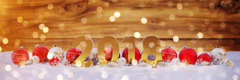 2018 new year eve with christmas baubles and candles 3D renderin. 2018 new year eve with red and white christmas baubles and candles 3D rendering Royalty Free Stock Image