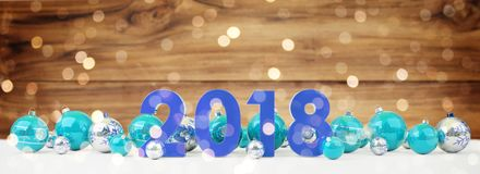 2018 new year eve with christmas baubles lined up 3D rendering. 2018 new year eve with blue and white christmas baubles on snow background 3D rendering Stock Photography