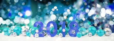 2018 new year eve with christmas baubles lined up 3D rendering. 2018 new year eve with blue and white christmas baubles on snow background 3D rendering Royalty Free Stock Image