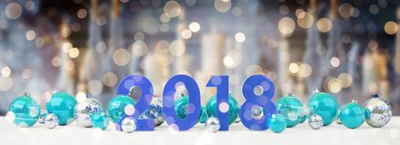 2018 new year eve with christmas baubles lined up 3D rendering. 2018 new year eve with blue and white christmas baubles on snow background 3D rendering Stock Photos