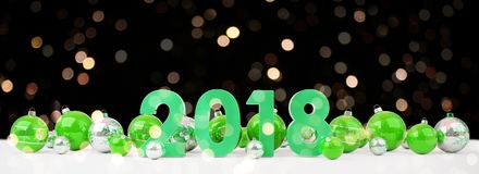 2018 new year eve with christmas baubles lined up 3D rendering. 2018 new year eve with green and white christmas baubles on snow background 3D rendering Royalty Free Stock Images