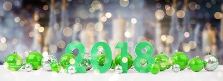 2018 new year eve with christmas baubles lined up 3D rendering. 2018 new year eve with green and white christmas baubles on snow background 3D rendering Stock Image