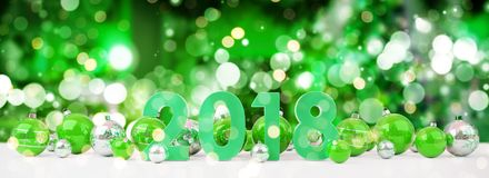 2018 new year eve with christmas baubles lined up 3D rendering. 2018 new year eve with green and white christmas baubles on snow background 3D rendering Royalty Free Stock Photo