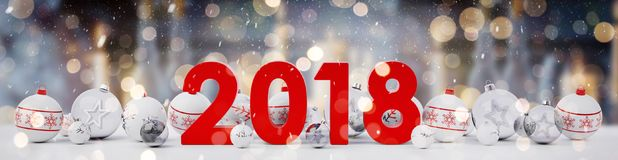 2018 new year eve with christmas baubles lined up 3D rendering. 2018 new year eve with white and red christmas baubles on snow background 3D rendering Stock Photo