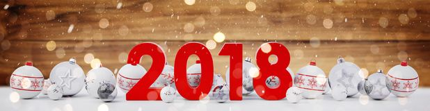 2018 new year eve with christmas baubles lined up 3D rendering. 2018 new year eve with white and red christmas baubles on snow background 3D rendering Royalty Free Stock Image