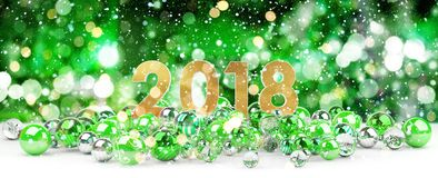 2018 new year eve with christmas baubles 3D rendering. 2018 new year eve with green and white christmas baubles 3D rendering Stock Photos