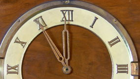 New year eve, 12 hours. Old wooden vintage clock with roman numbers. Time stops at 12 hours midnight or noon stock footage