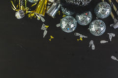 New Year Eve. Party decorations on black board Stock Photos