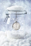New Year Eve. With pocket watch set to midnight in snowy setting Royalty Free Stock Photo