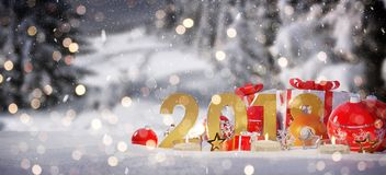 2018 new year eve with christmas baubles and gifts 3D rendering. 2018 new year eve with red and white christmas baubles and gifts 3D rendering Royalty Free Stock Photo