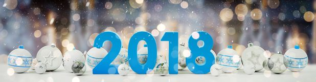 2018 new year eve with christmas baubles lined up 3D rendering. 2018 new year eve with white and blue christmas baubles on snow background 3D rendering Stock Image