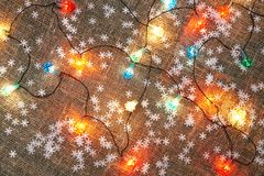 New Year fairy lights on a table to be used as background. Christmas / New Year fairy lights on a table to be used as background Royalty Free Stock Photography