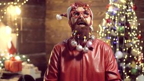 New year fashion clothes. Delivery gifts. Santa Claus - bearded hipster. Christmas decorations. Gift emotions. Styling. Santa Claus with a long beard posing on stock footage
