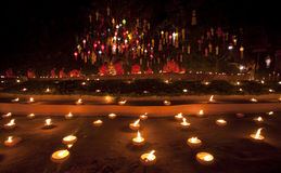 New year festival, Buddhist monk fire candles to t Stock Image