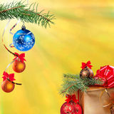 New Year festive background. Christmas and New Year festive bokeh background, gift and balls, place for holiday text Stock Photography