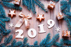 New Year 2019 festive background with 2019 figures, Christmas toys, blue fir tree branches and snowflakes - 2019 design royalty free stock photos