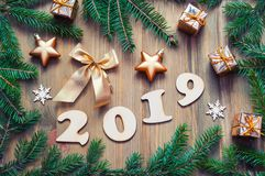 New Year 2019 festive background with 2019 figures, Christmas toys,green fir tree branches and snowflakes - 2019 design. New Year 2019 background with 2019 stock photo
