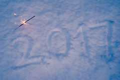 New year, figures on the snow,. 2017 new year, figures on the snow, footprints in the snow, Sparkler Royalty Free Stock Photo