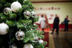 New Year fir with balls. And garlands in mall Royalty Free Stock Photography