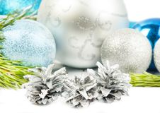 New Year fir tree branch and three cones on white background Stock Photography