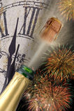 New year firework. Popping champagne with firework and watch at new year stock photography