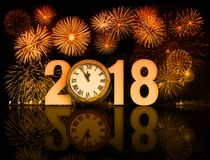 New year 2018 fireworks with clock face. 2018 happy new year fireworks with old clock face Royalty Free Stock Photos