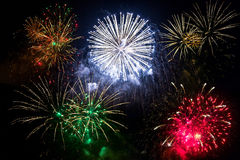 New year fireworks on the sky. New year fireworks display over dark sky royalty free stock images