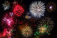 New year fireworks on the sky. New year fireworks display over dark sky Royalty Free Stock Image