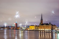 New Year Fireworks 2016 in Stockholm. Stockholm, Sweden – Jan 1, 2016: New Year Fireworks are popping across Stockholm islands and city hall on Jan 1 in stock image