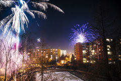 New Year fireworks. New Years Eve celebration over a city square Royalty Free Stock Photos