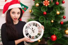 New Year 2018. Five to twelve. Young beautiful woman with big clock and party decoration Royalty Free Stock Image