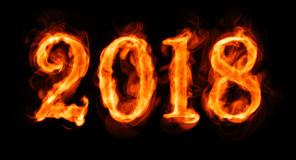 New year 2018 flaming number on black Royalty Free Stock Image