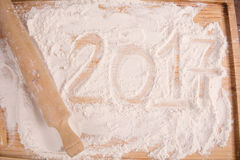 New 2017 year on flour. Happy new 2017 year on flour on wooden background. New year concept Stock Photography