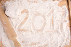 New 2017 year on flour. Happy new 2017 year on flour on wooden background. New year concept Stock Photo