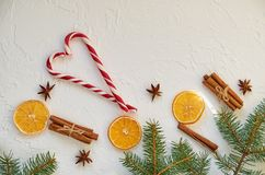 New year food decorations with fir branches, red candy cones and traditional spices for mulled wine – anise stars, cinnamon stock photography